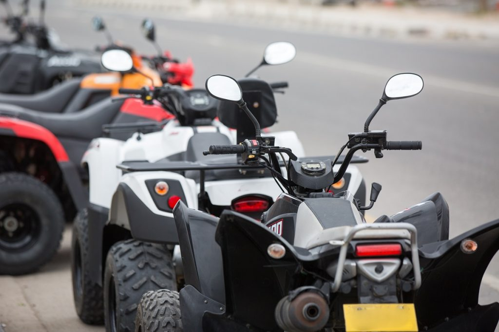 Lined up quad bikes