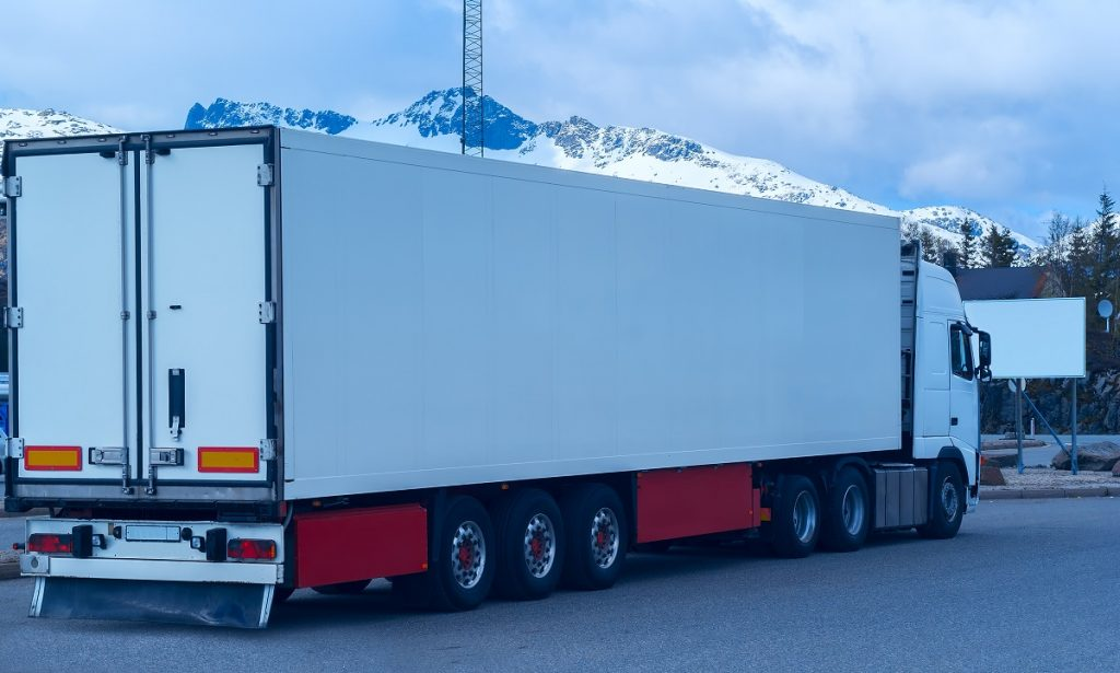 Refrigerated truck with side guards