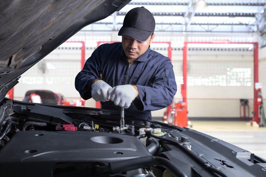 Mechanic examining engine
