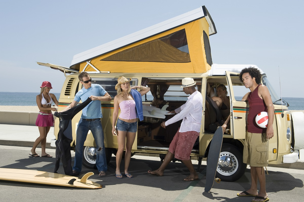 Group of young people by a campervan