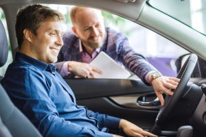 Man testing the car he is about to rent