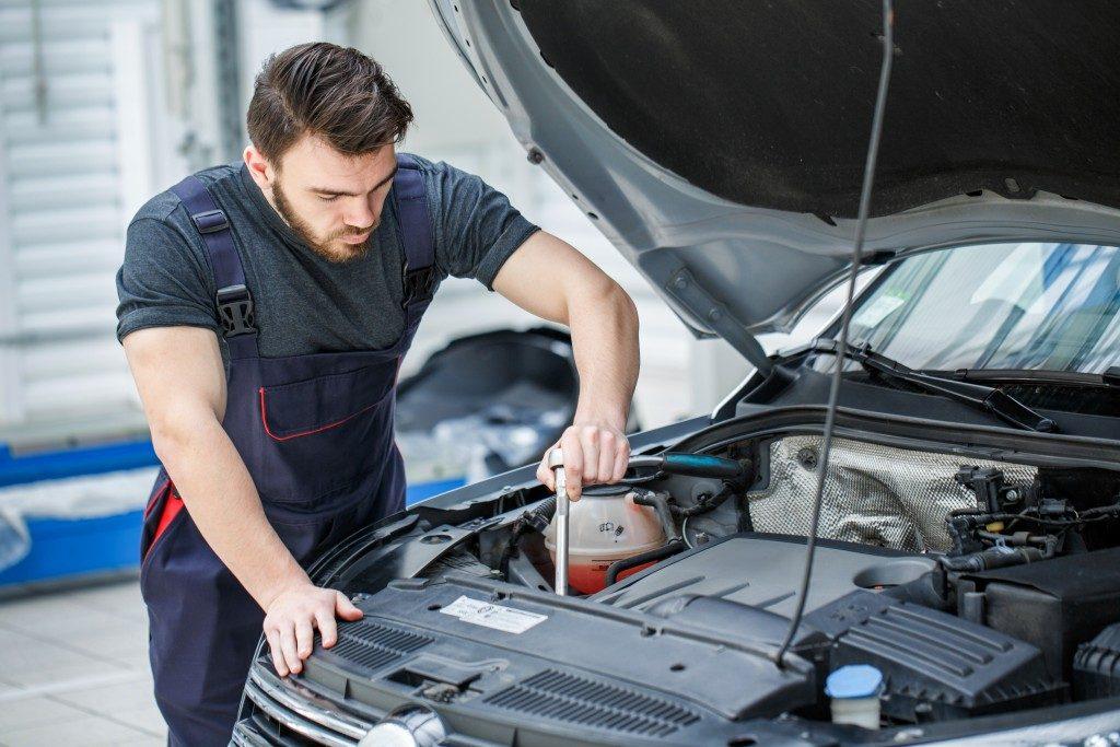 mechanic checking the car engine