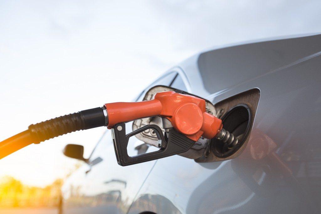 Putting gasoline in a car
