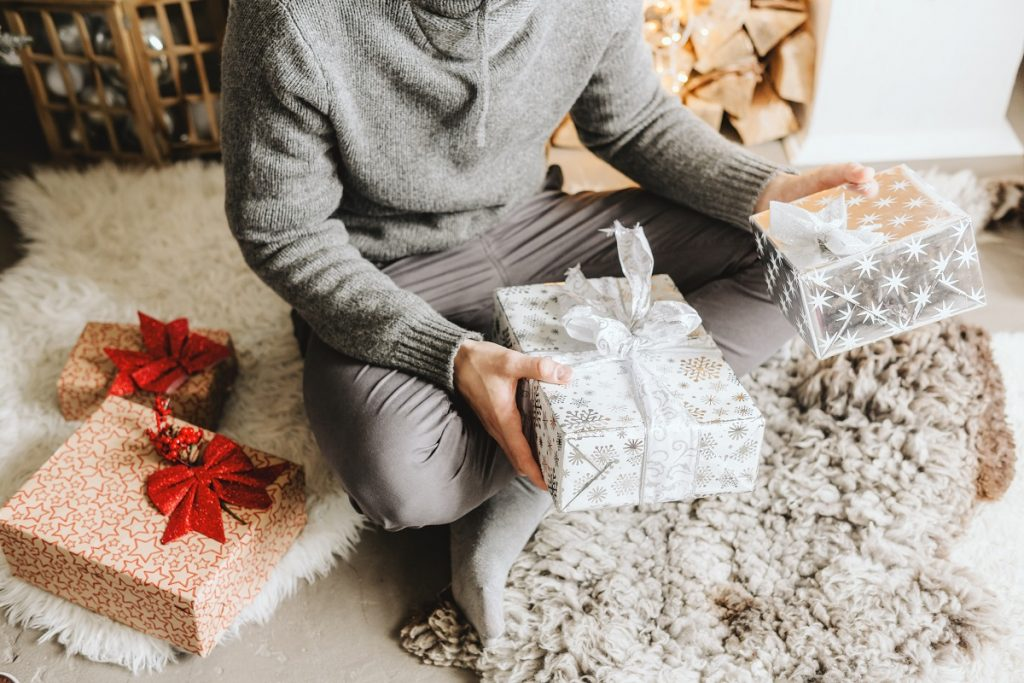 Man holding gifts for Christmas at home