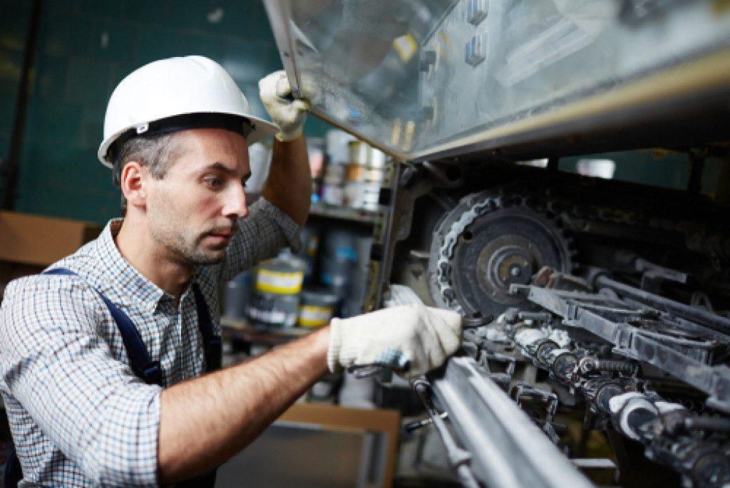 man checking the car parts