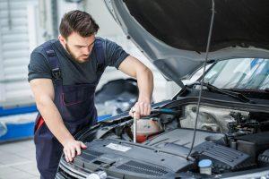 person fixing car